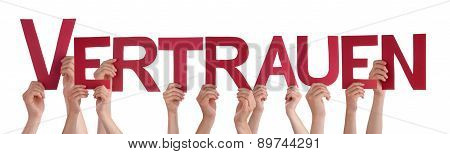 People Holding Straight Word Vertrauen Means Trust