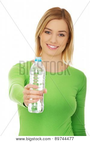Happy woman with bottle of water.