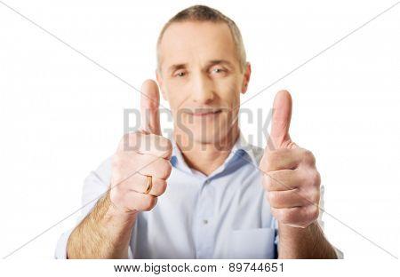 Portrait of mature man gesturing ok sign.