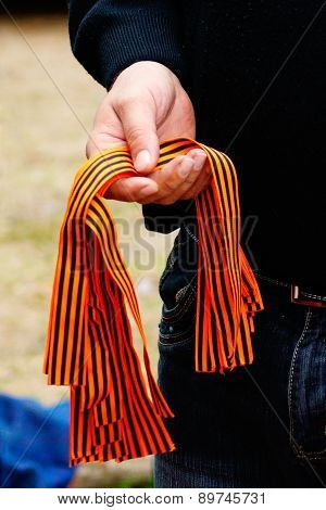 Man offering Saint George's Ribbons