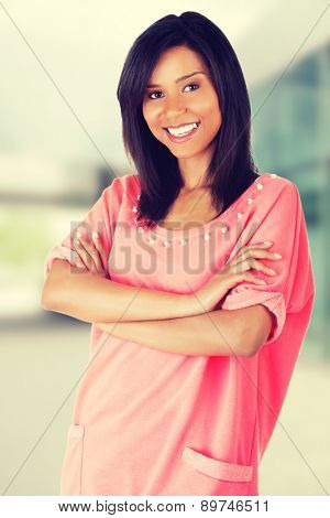Happy woman posing in pink shirt