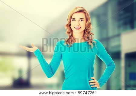 Woman showing something on copyspase for product