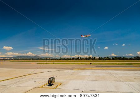 Departure flight Avianca airplane cruising the sky at El Dorado airport in Bogota Colombia