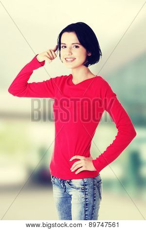 Young happy woman gesturing