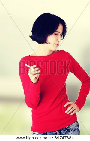 Young woman smoking a cigarette