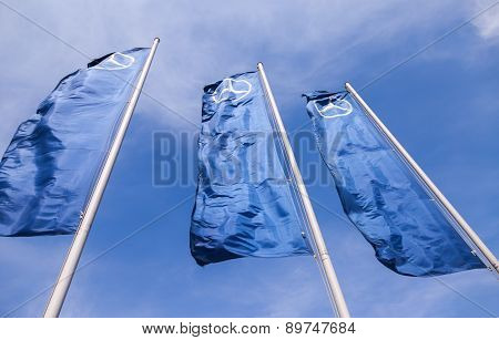 The Flags Of Mercedes-benz Over Blue Sky
