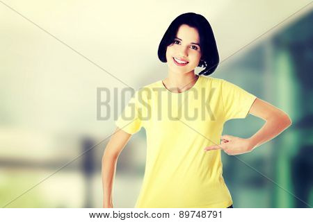 Cheerful woman posing in blue shirt