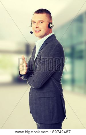 Customer service representative gesturing thumbs up