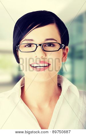 Young happy businesswoman in glasses portrait