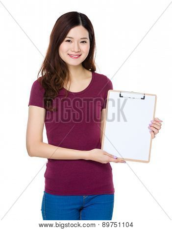Young woman show with clipboard