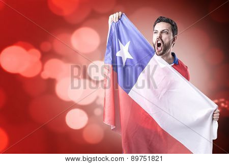 Chilean Soccer player on red bokeh background
