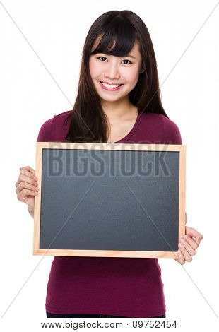 Woman show with black board