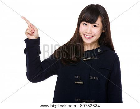 Young woman with finger pointing up