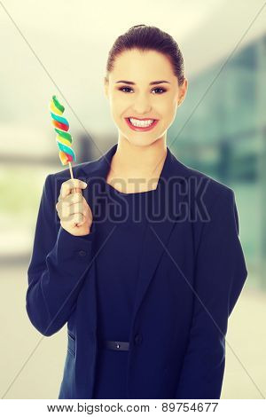 Beautiful business woman with lollipop.