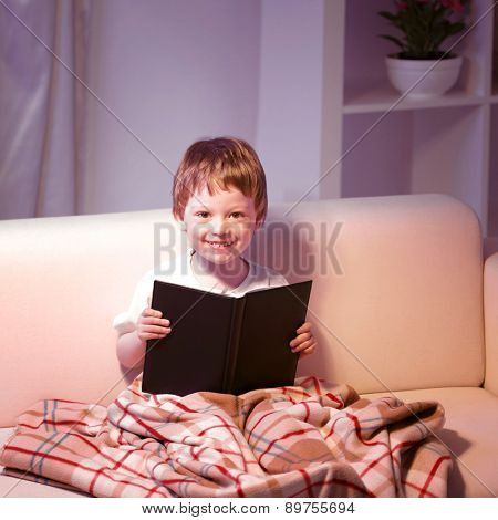 boy read book indoors