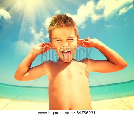 Summer Holidays. Vacation. Joyful Boy having fun at the beach. Travel and Vacation concept. Happy Little Kid Having Fun on seaside