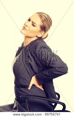 Young businesswoman having back pain