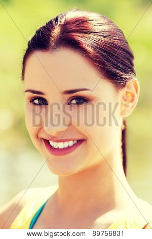 Beautiful happy woman wearing sporty suit
