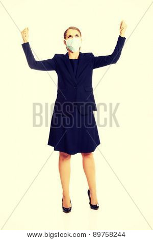 Beautiful businesswoman with protecting mask