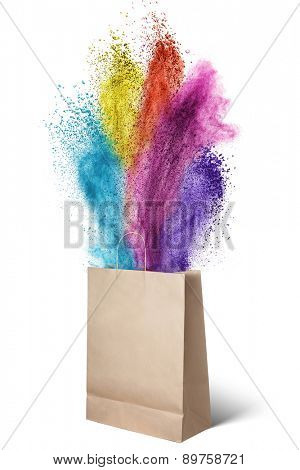 Paper bag with color powder splash isolated on white background