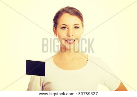 Smiling woman holding a small panel