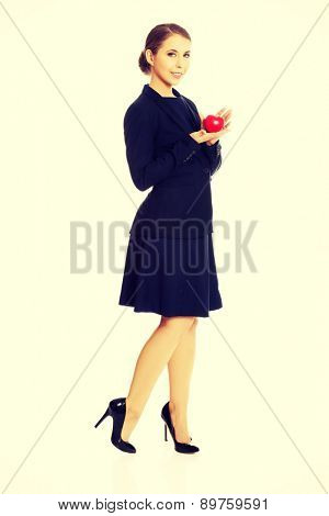 Happy businesswoman holding heart model