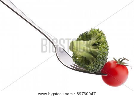 Fresh raw vegetables on fork isolated on white background cutout. Healthy eating concept.