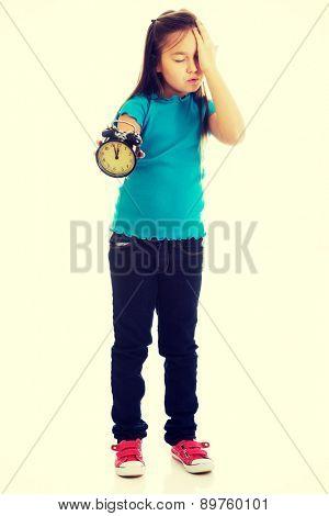 Cute little girl holding alarm clock