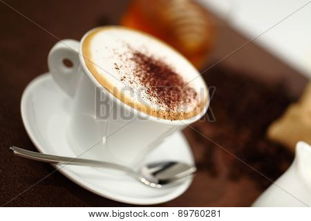 Cup Of Cappuccino On The Table For Breakfast