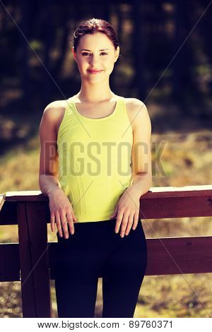 Beautiful woman relaxing after running