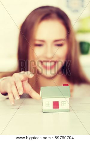 Young woman buying new house