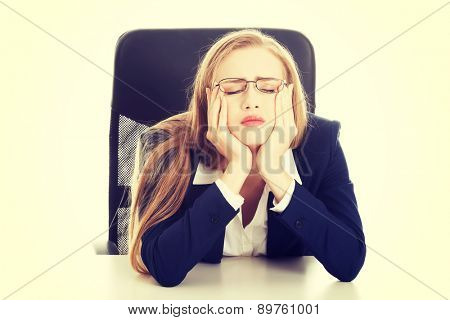 Beautiful young blonde tired businesswoman
