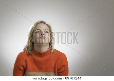 Young Pretty Blonde Girl Shrugging Shoulders
