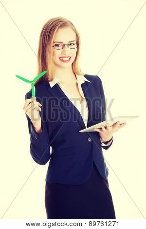 Caucasian businesswoman holding a model of propeller