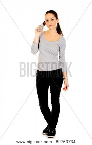 Young teenage woman talking on the phone.