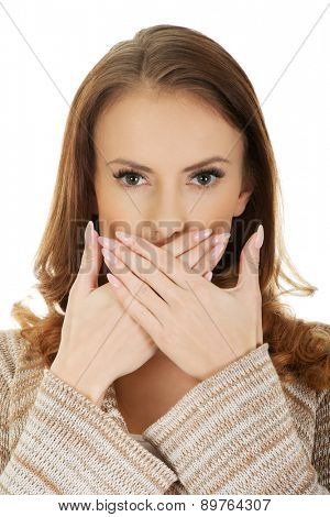 Beautiful woman covering mouth with her hand.
