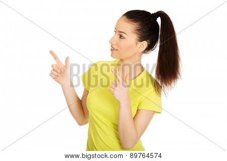 Young student woman pointing up with both hands.