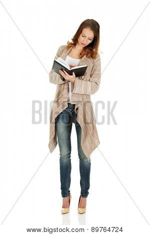Casual woman writing in notebook.
