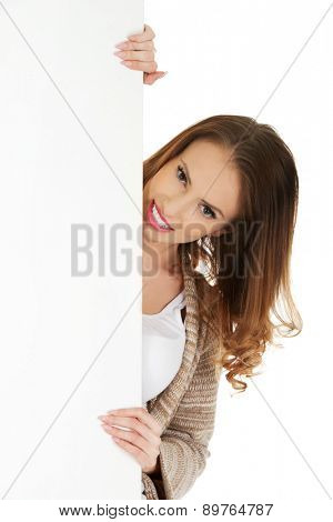 Beautiful happy woman with blank board.