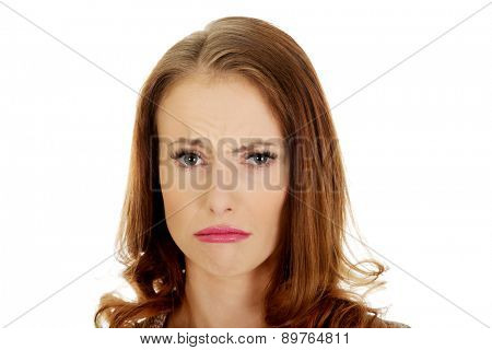 Depressed woman with grimace on face.