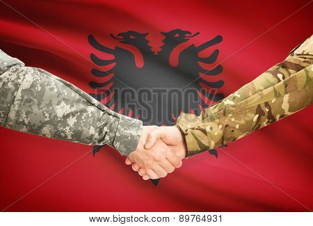 Men In Uniform Shaking Hands With Flag On Background - Albania