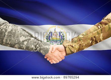 Men In Uniform Shaking Hands With Flag On Background - El Salvador