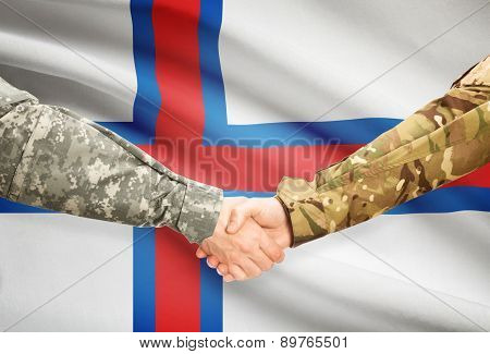 Men In Uniform Shaking Hands With Flag On Background - Faroe Islands