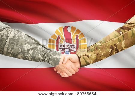 Men In Uniform Shaking Hands With Flag On Background - French Polynesia