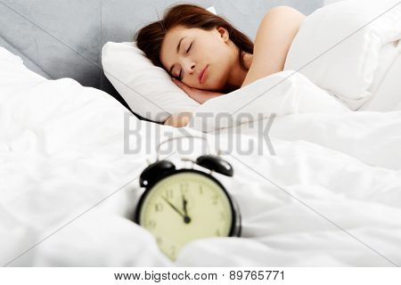 Beautiful woman sleeping in bed.