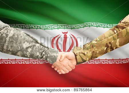 Men In Uniform Shaking Hands With Flag On Background - Iran