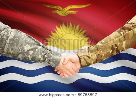 Men In Uniform Shaking Hands With Flag On Background - Kiribati