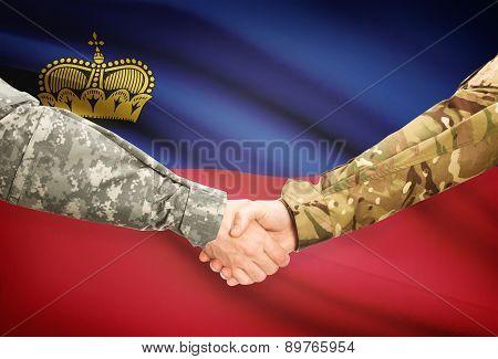 Men In Uniform Shaking Hands With Flag On Background - Liechtenstein