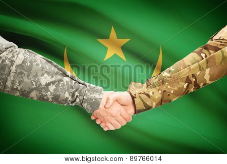 Men In Uniform Shaking Hands With Flag On Background - Mauritania