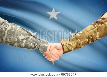 Men In Uniform Shaking Hands With Flag On Background - Micronesia